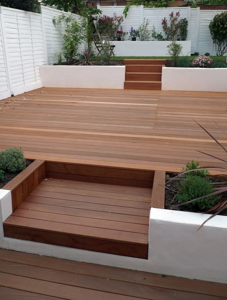 Hardwood decking white retaining walls