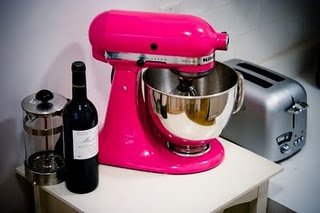 Pink Kitchenaid mixer. It is hot pink!!! I  may not own dishes but I will own this soon!