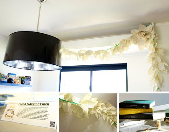 handmade garland, using books as risers for food, and cards with the food item, author info and quote