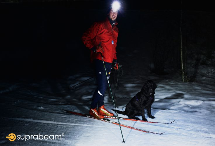 A professional ski runner and his dog.