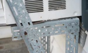 Support a Window Air Conditioner With Brackets