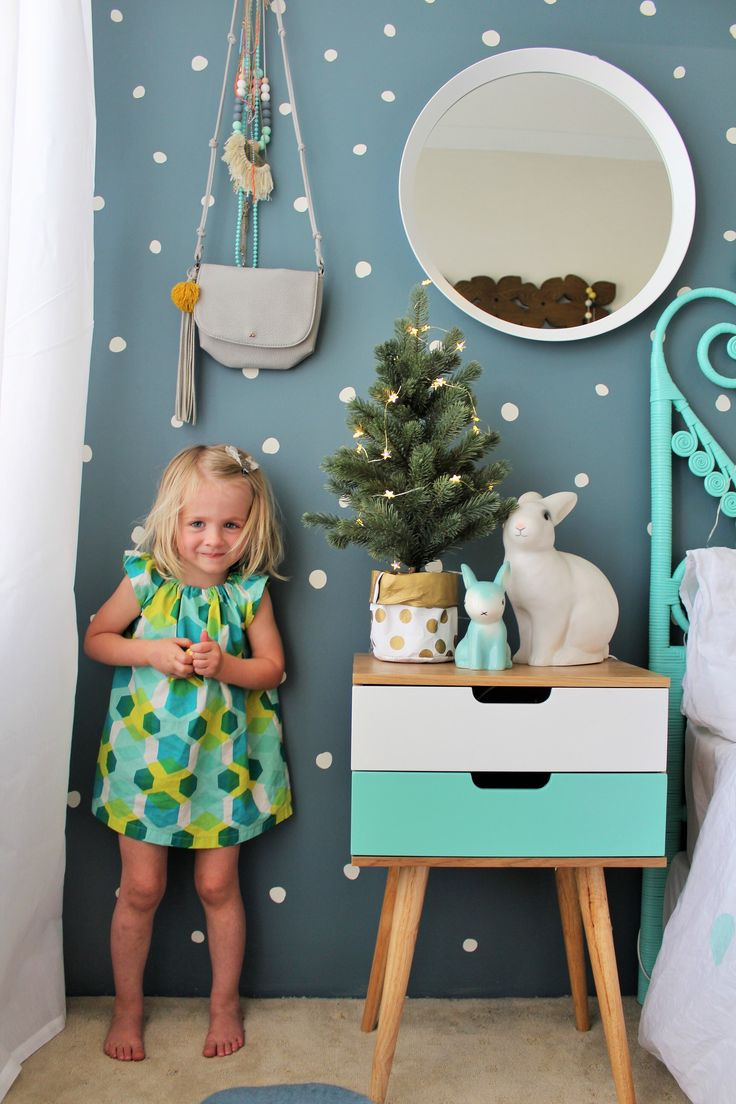 Indi in her sisters colourful bedroom wearing a cute retro swing dress more on the blog www.fourcheekymonkeys.com