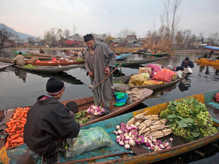Kashmiri vendors sell vegetables at the floating market on Dal Lake, which is one of the valley's major tourist attractions  Dar Yasin