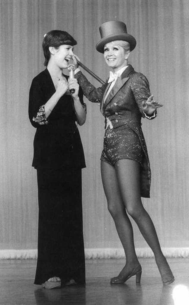 It's Show Time from Debbie Reynolds & Carrie Fisher's Mother-Daughter Moments  This throwback image of the two was used as a promo pic for their 2016 documentaryBright Lights: Starring Carrie Fisher and Debbie Reynolds.