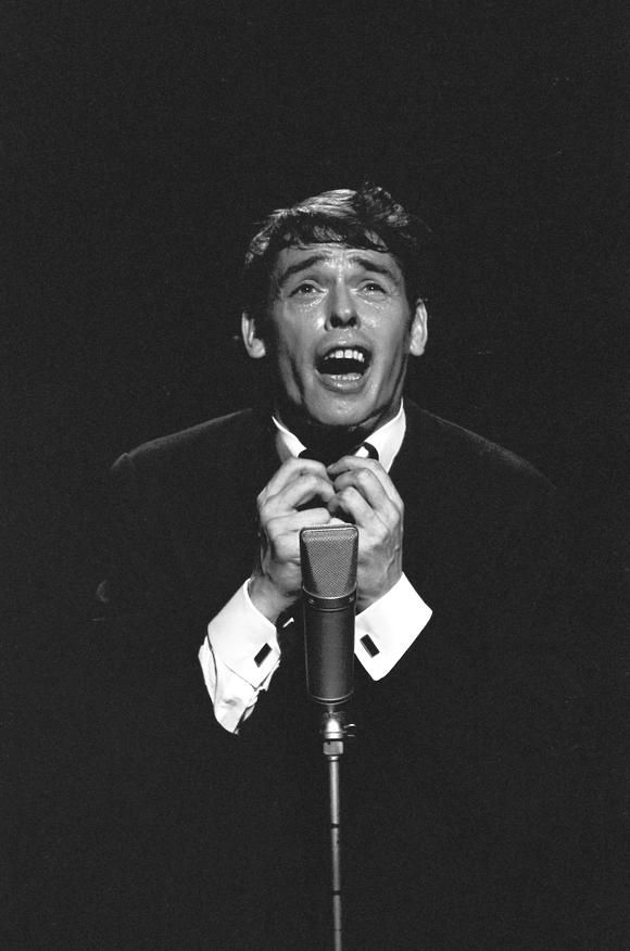 Jacques Brel (1929-1978) - Belgian singer-songwriter who composed and performed literate, thoughtful, and theatrical songs that generated a large, devoted following, initially in Belgium and France, later throughout the world. He was widely considered a master of the modern chanson. Photo Jean-Claude Deutsch, 1966