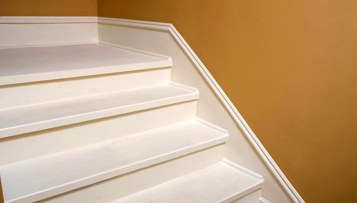 Faux BaseboardBrought to you by Lowe's Creative Ideas Create the look of custom trim work with this simple faux baseboard project. It's an easy way to dress up a stairway or entry. (Great idea!! I am definitely doing this on the weekend!)