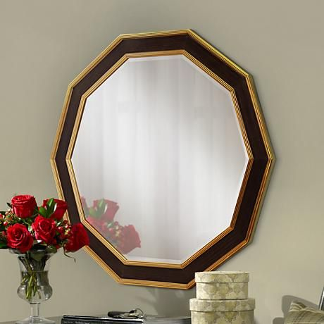 A bold geometric wall mirror in a beautiful gold trim in the inner and outer frame.