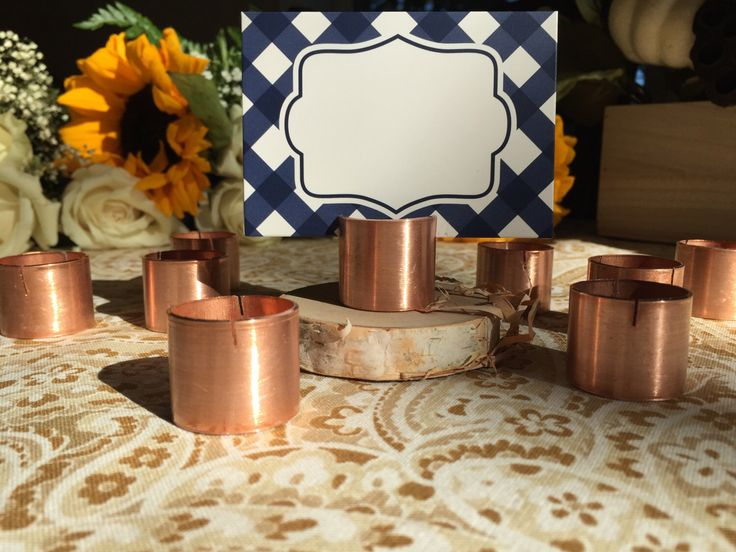 A personal favorite from my Etsy shop https://www.etsy.com/listing/474898110/25-copper-place-card-holders-industrial