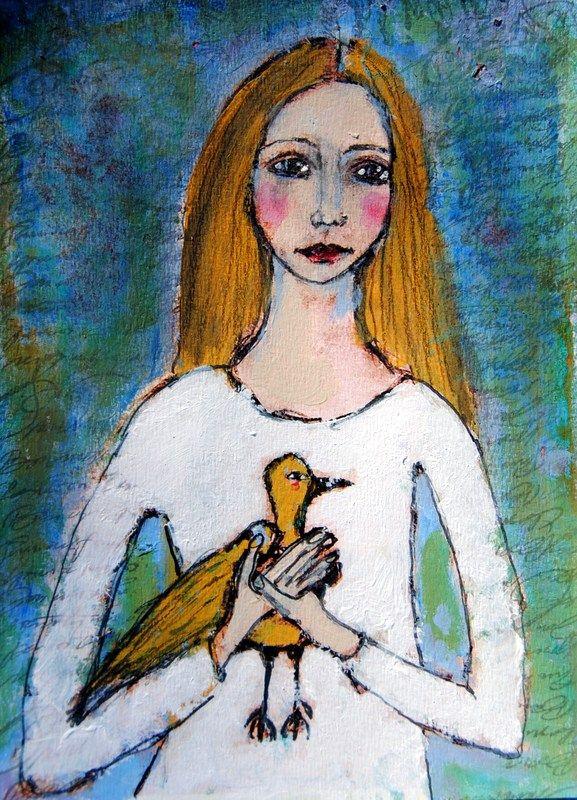A girl holding a bird