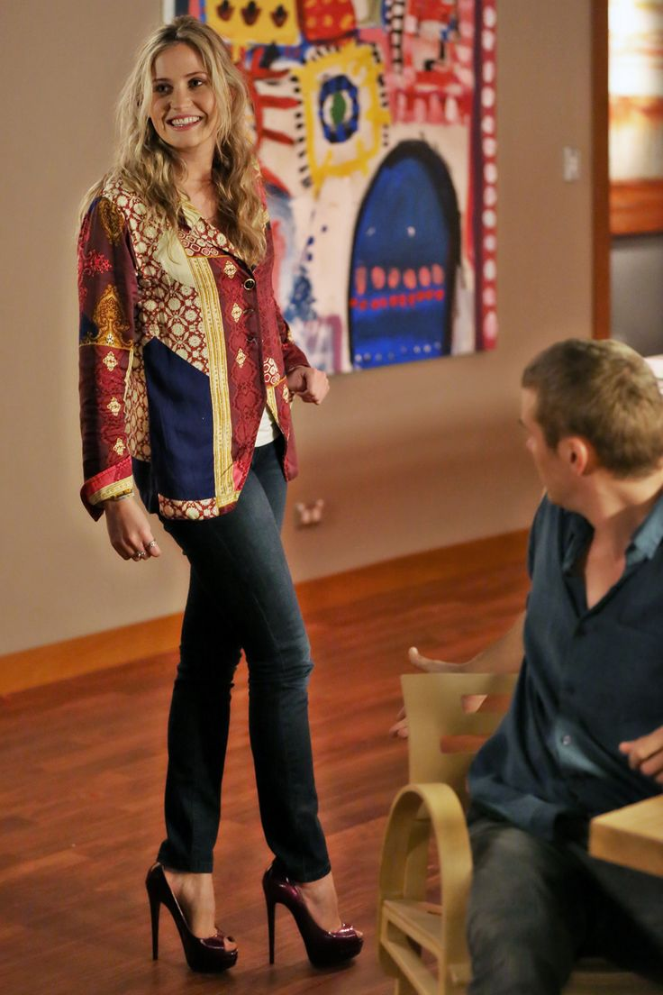 Miranda wears a jacket from Tallow, a camisole from Free Fusions, and shoes by Peep Toe.