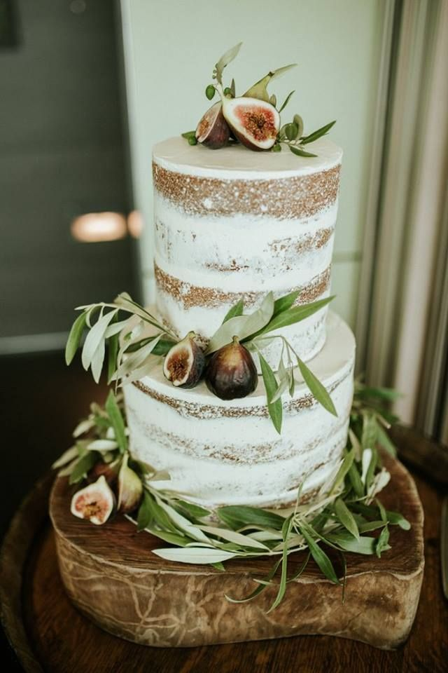 Naked Fig and Olive Leaf Wedding Cake by Eleos Cakes Instagram @eleoscakes | Photo by www.sophietphotog... | Rustic Cake Board available for hire from www.thesmallthing... | Melbourne based wedding hire company