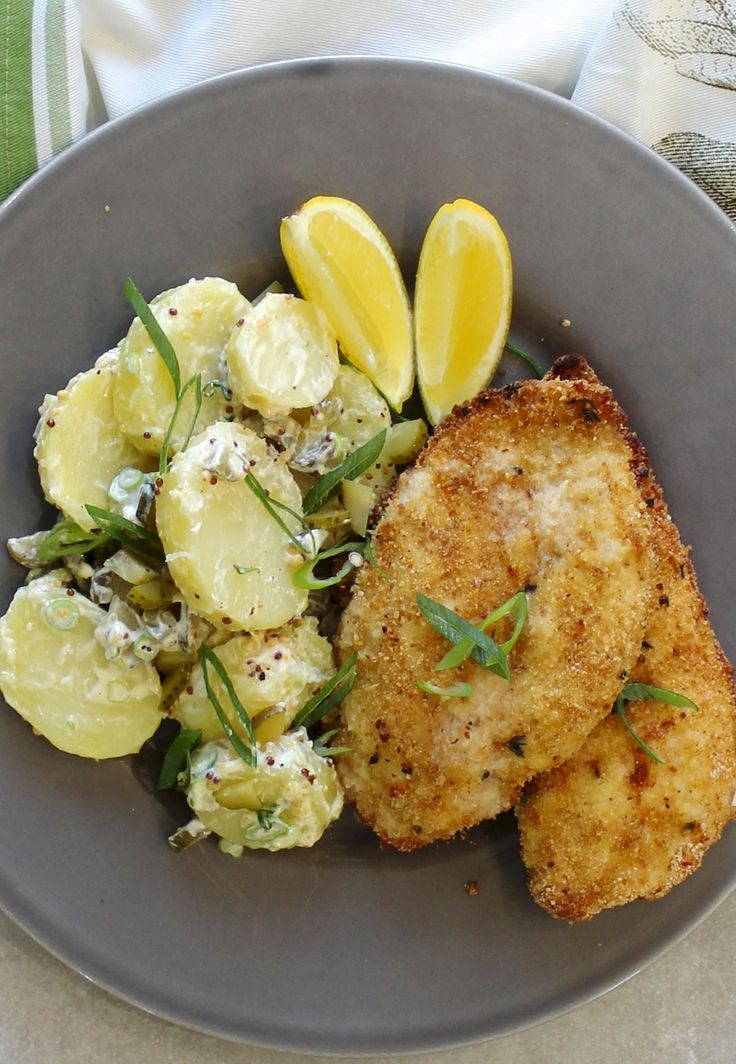 THYME & GARLIC CHICKEN SCHNITZEL WITH A DUTCH CREAM POTATO SALAD. Free range chicken schnitzel with a classic German style potato salad. A winner any night of the week.