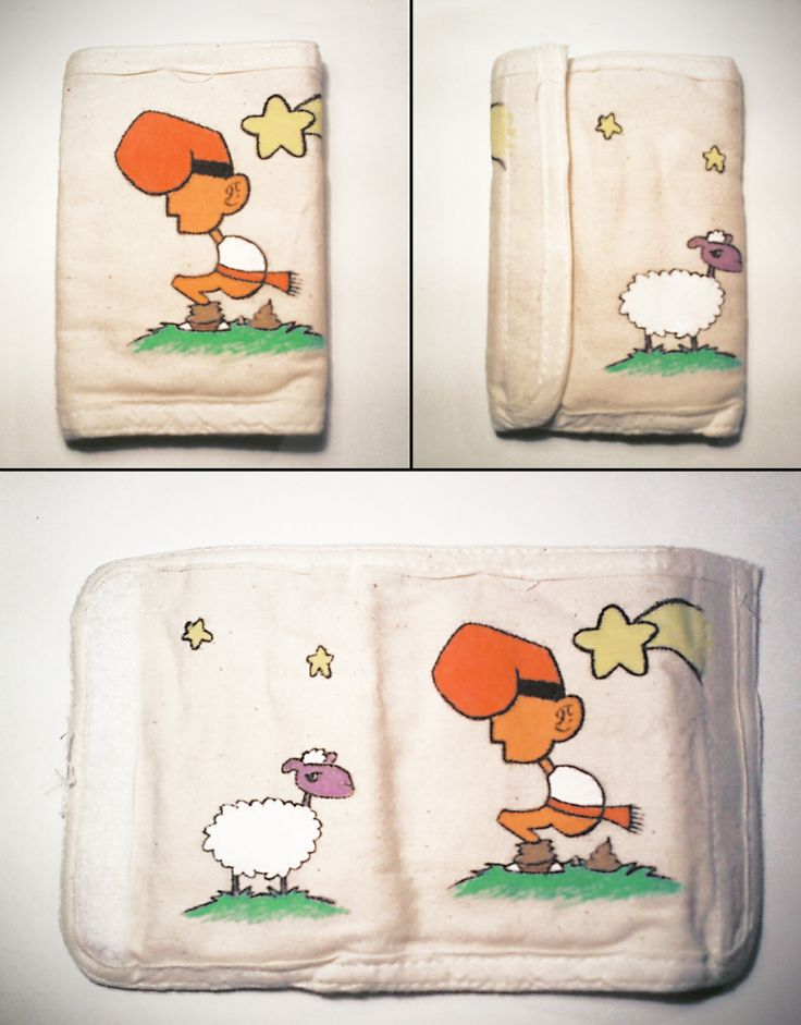 """Billetero """"Caganer"""", 100% algodón pintado a mano con pinturas y rotuladores textiles. Tiene compartimentos para tarjetas y monedas."""