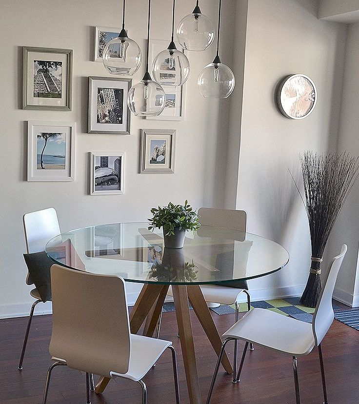 small dining room decor dining room decor ideas small dining with round glass topped stable modern style hanging glass orb light fixtures and simple gallery wall apartment