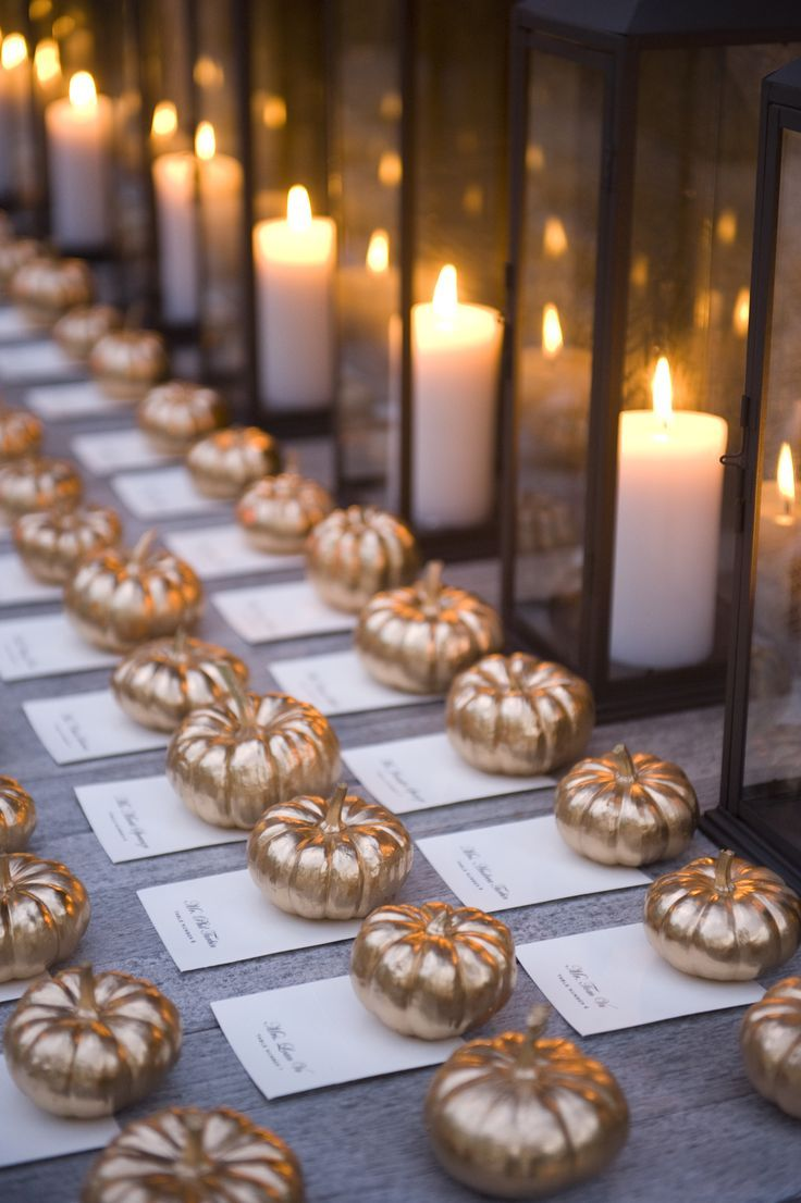 Adorable gold pumpkins weigh down these place cards gold Places to have a fall wedding