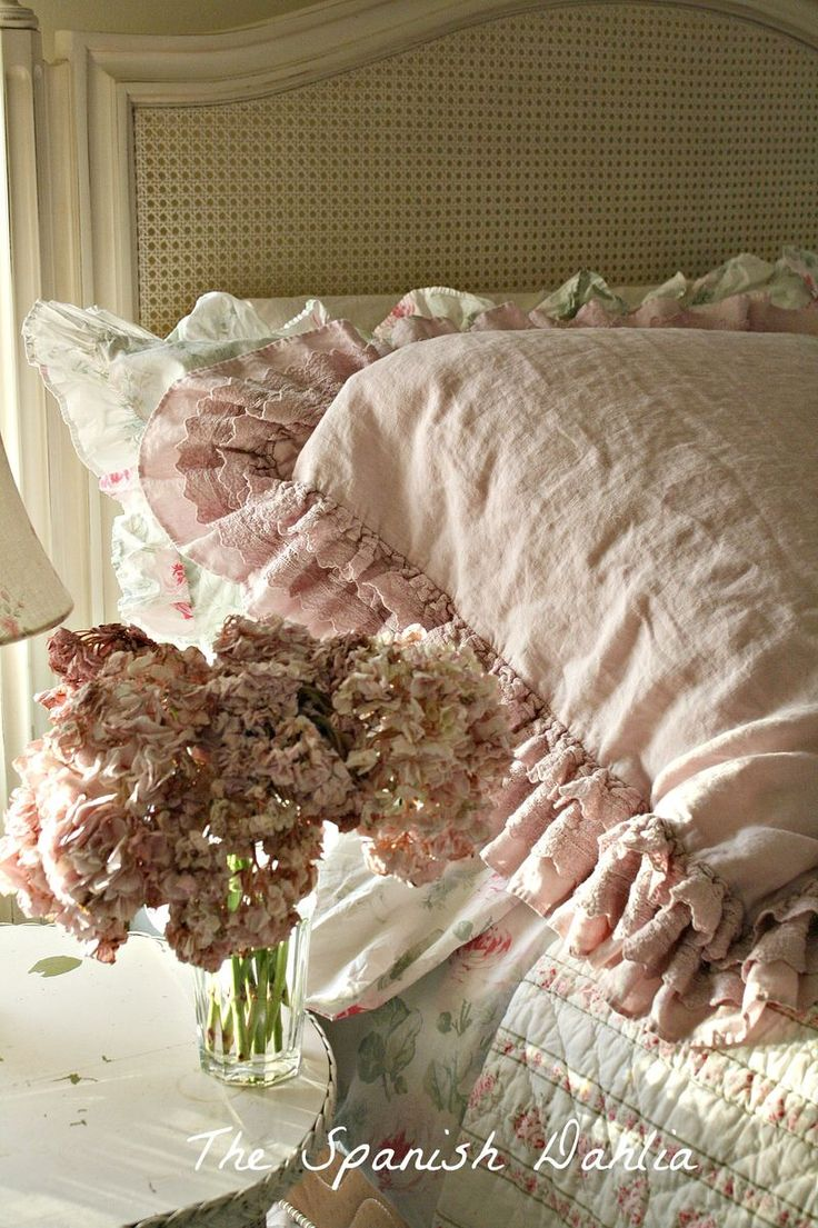 Love this antique looking pink pillow