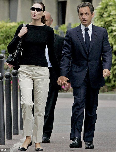 I admire Carla Bruni-Sarkozy's style...  Flats, legs, clean lines, demure necklines