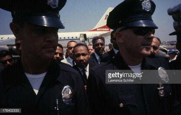 Civil Rights and religious leader Dr. Martin Luther King Jr. (1929 - 1968) (center) arrives at Los Angeles International Airport during the Watts Riots, Los Angeles, California, August 17, 1965.