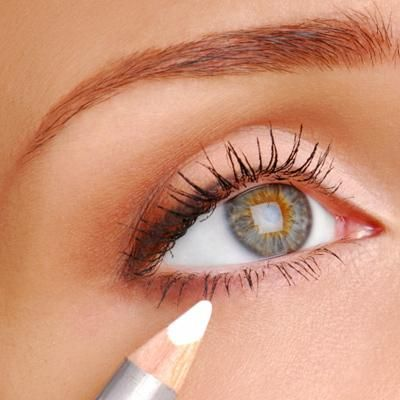 Makeup expert tricks: (1) For softer eyes, layer the top lid with black eyeliner, and the bottom lid with brown eyeliner. Also, (2) you can use white eyeliner to make eyes pop by lining the inside of the lower lid, and lightly lining the part where the upper and lower lids meet if your eyes need to look farther apart.
