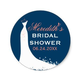 Round bridal shower favor stickers feature a wedding gown, a color scheme of white, navy blue, blush, and coral pink, and custom text that can be personalized with the bride's name and event date.