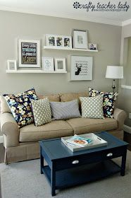Wall decor - I like the arrangement of frames...asymmetrical but balanced