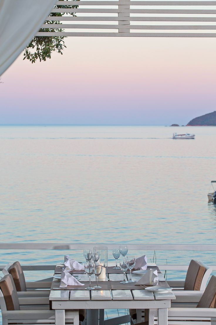 The violet sky and the blue water will steal your heart away, just like our culinary treasures! #culinary #skiathos #kassandrabay