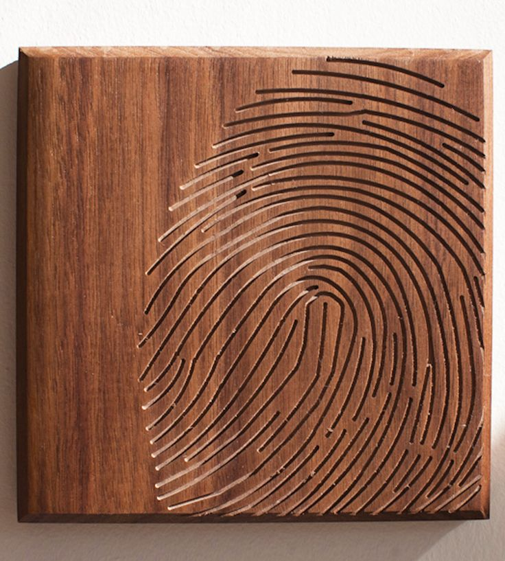 Fingerprint Wood Art to do with wood burning. Or a carving tool.