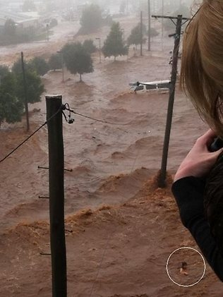 Jan.10.2011.Teenager(circled lower rt.)swims for her life,and survives Fatal Flash-flooding.Toowoomba.Qld.Australia.