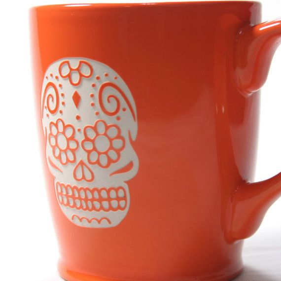 Dia de los Muertos! We carved all the way through the bright tangerine glaze of this extra large mug so that the bold natural ceramic can be seen.
