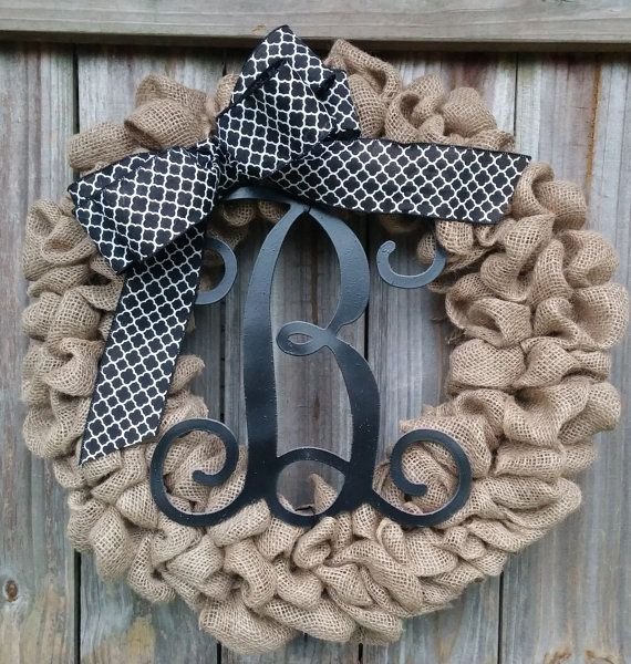 This burlap wreath is made with burlap, a bow, and a wooden monogram in the center. It measures approximately 21 inches in diameter, and should