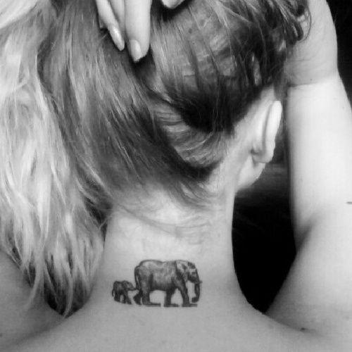 .Mama and baby elephant tat