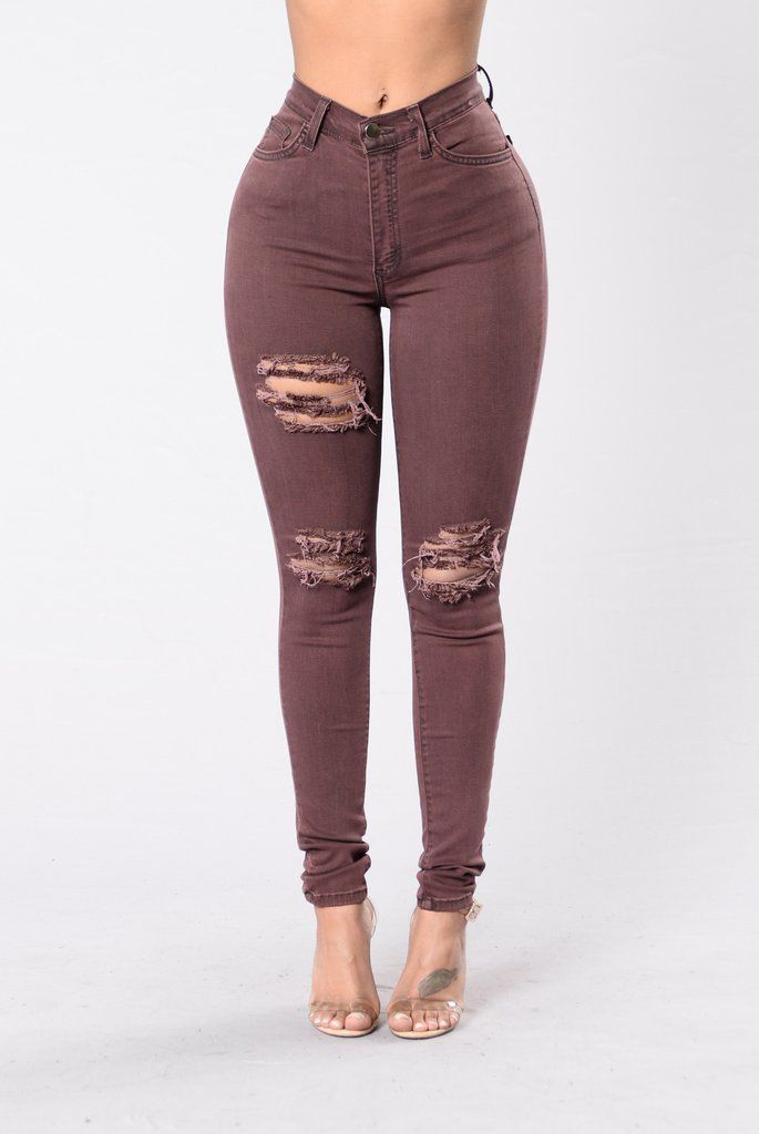 - Available in Burgundy - High Rise - 5 Pocket Design - Laser Cut Knee - Thigh Slit - Skinny Leg - Made in U.S.A - 53% Rayon, 26% Cotton, 19% Polyester, 2% Spandex