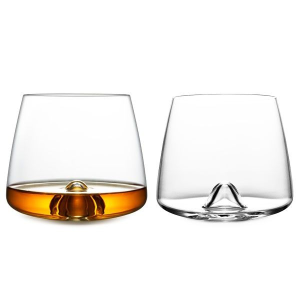 Normann Copenhagen Whiskey Glasses has a wide bottom that grants stability and places the glass perfectly in the palm of your hand. The bottom curve creates a natural movement of the content increasin