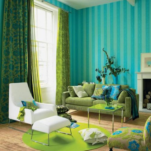 Decorating ideas for living rooms with high ceilings can be daunting but never fear - turquoise stripes and sweeping green patterned drapes accentuate the space's dramatic configuration.: