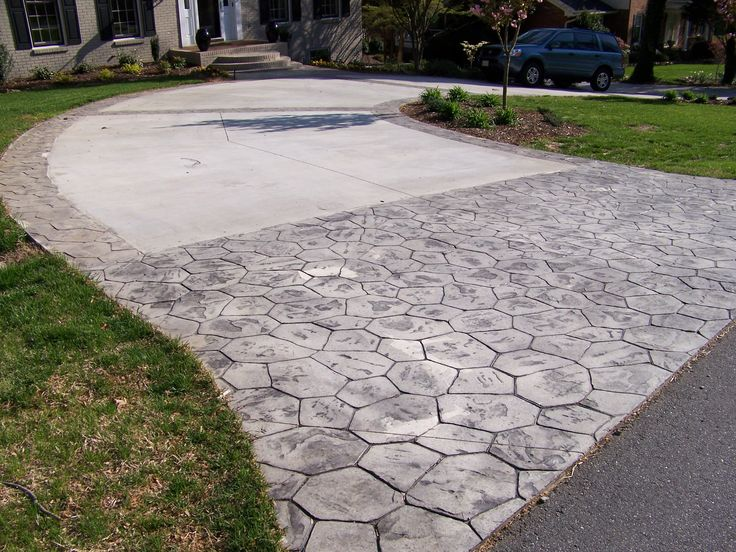 Faux cobblestone at end and around edges of driveway for for Faux brick edging