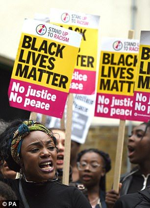 Up to 150 people, many holding up Black Lives Matter placards, brought traffic to a standstill outside east London's Stoke Newington Police Station in a vigil for Rashan Charles, 20