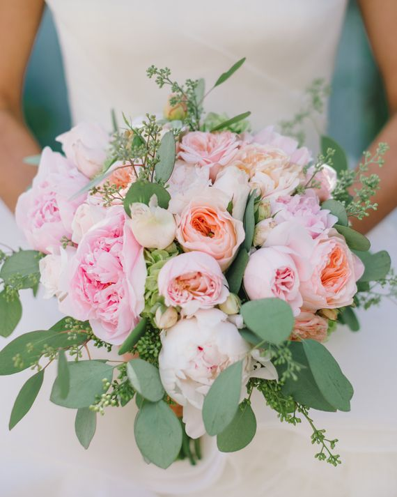 This pink-and-sage bridal bouquet from Julie Stevens Designs includes garden and standard roses, along with peonies and hydrangeas on seeded eucalyptus and standard eucalyptus leaves.
