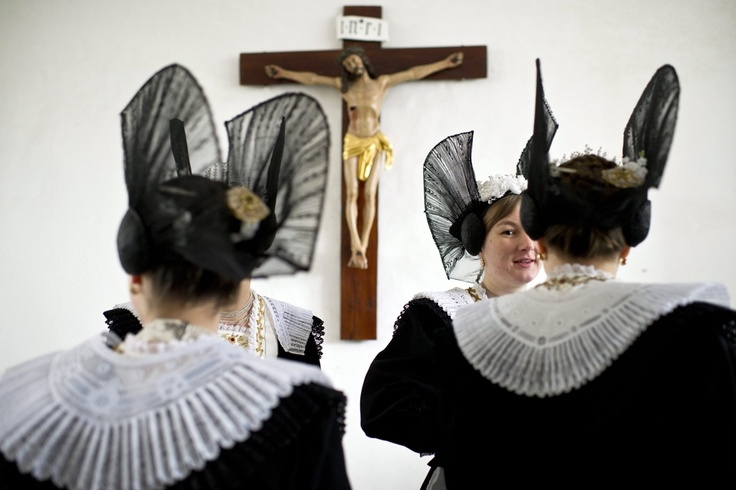 TRADITIONAL DRESS: Women wearing traditional costumes waited for holy communion on the occasion of the Feast of Corpus Christi in Appenzell, Switzerland, Thursday. Corpus Christi is celebrated on the Thursday after Trinity Sunday. (Ennio Leanza/European Pressphoto Agency)