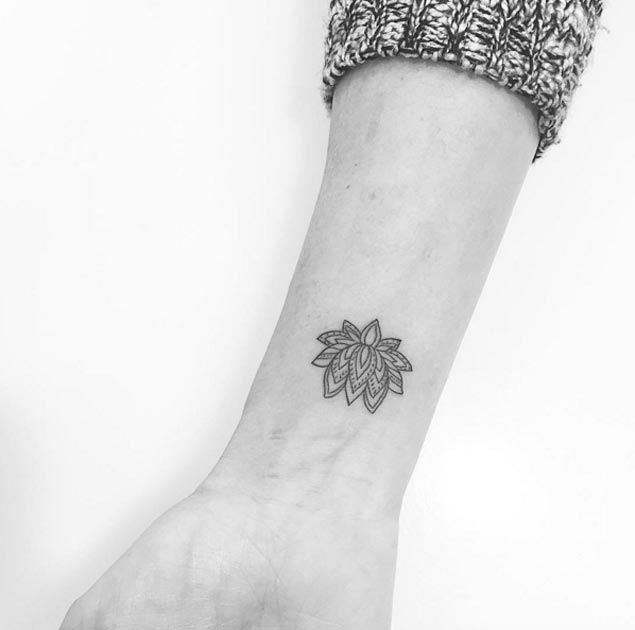 Minimalistic Lotus Flower Tattoo by Jon Boy - between shoulders