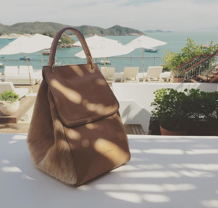 Saturdays are made for resting, remembering our trip to Brazil with La Virginia mini hobo in tan #luxurytravel #brazil #luxury #handcrafted #handbags #madeincolombia #latindesign #IsidoraMalva
