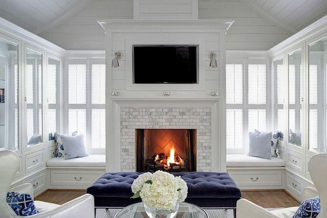 Blue and white bedroom with fireplace and window seat nook. #Bedroom #Whitebedroom #BlueandWhiteBedroom Dixon Kirby Homes.