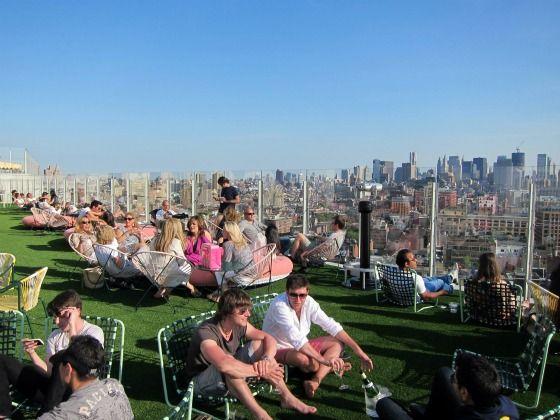 an artificial lawn creates an informal gathering spot @ the standard nyc