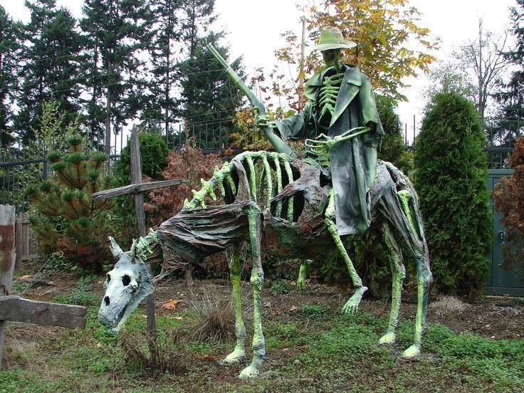 a skeleton horse rider outdoor home haunt display during halloween