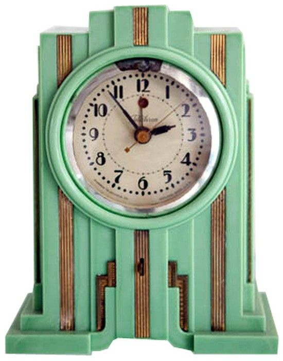 """Telechron American Art Deco Skyscraper Clock in Mint Green Produced from about 1929 till 1931 this skyscraper styled American art deco table clock was made by the Warren Telechron Company. Known as the Model 700 and marketed as the """"Electrolarm"""", the clock came in three colors; walnut (brown Bakelite) and white or green """"Vinylite"""" (Plaskon). Brown colors are the most common, green the rarest."""