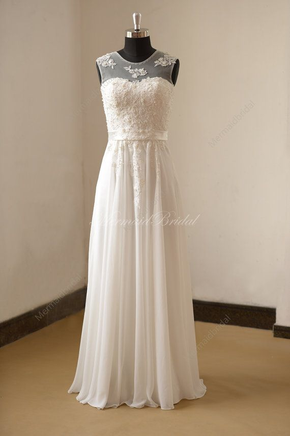Ivory chiffon lace wedding dress with illusion neckline and pearls Fabric: Chiffon Embellishment : Lace Silhouette:A line Back: Zipper up
