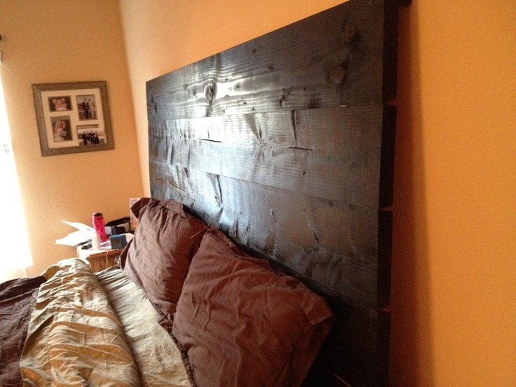 "This is a quick and easy (cheap) king size headboard. It is 6 - 2 x 10"" stained an Ebony miniwax stain. Screw boards onto 2 -2 x4"" and anchor it onto the wall! Done and under $50!!!"
