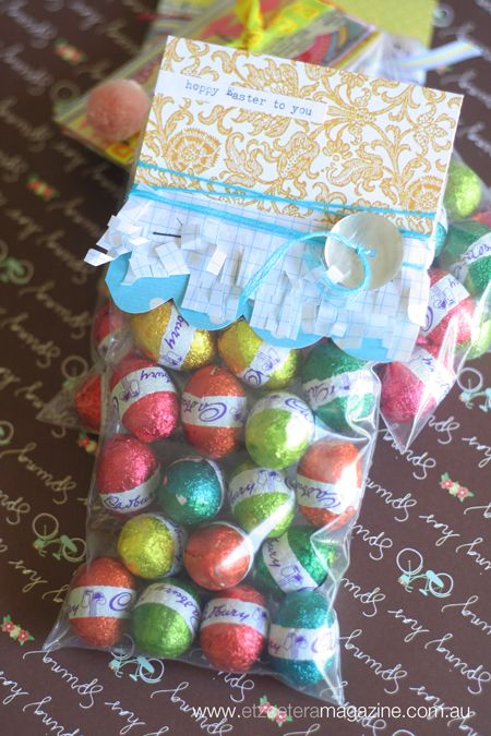A project by Kim Archer for our Easter With The Jot Girls blog series! Super easy chocolate eggs gift packs! Paper + thread + a button! Easy!