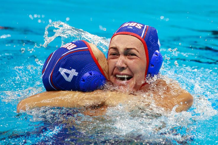Elvina Karimova #4 of Russia and Ekaterina Lisunova #2 of Russia celebrate winning the bronze during the Women's Water Polo Bronze Medal match between Hungary and Russia on Day 14 of the Rio 2016 Olympic Games at the Olympic Aquatics Stadium on August 19, 2016 in Rio de Janeiro, Brazil.
