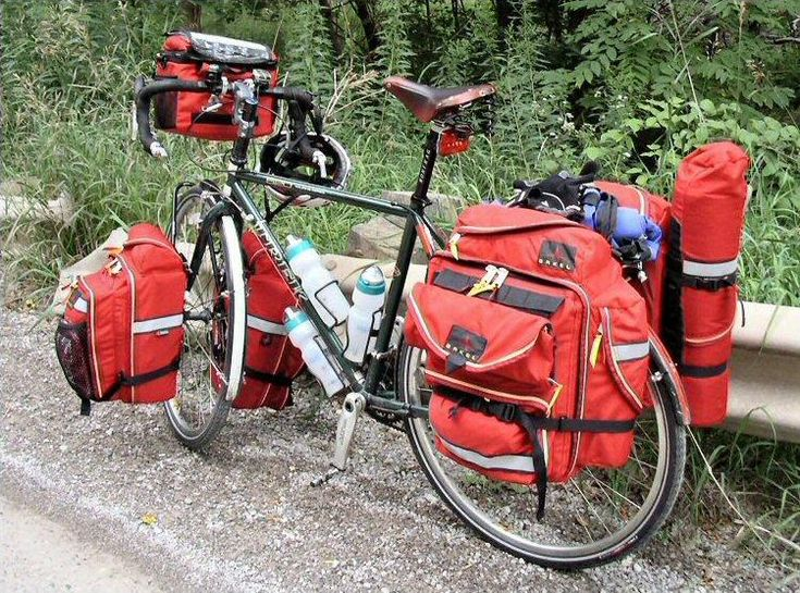 Great setup except for the fire engine RED bags.  Each to their own but BLACK is great for renegade or free camping where you don't want to stick out and may want to hide a bit.  fully loaded touring bike. I can see this happening this summer.......