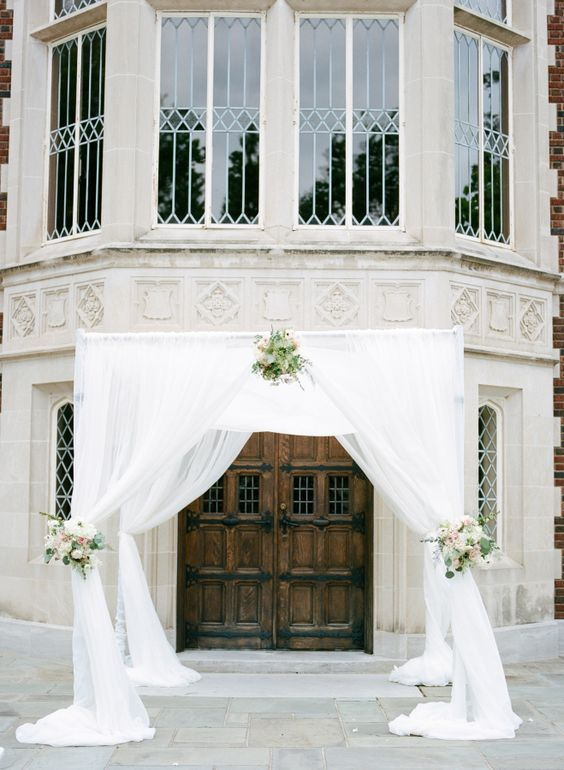 Classic draped ceremony arbor: http://www.stylemepretty.com/oklahoma-weddings/tulsa/2016/03/14/classic-tulsa-wedding-infused-with-art-deco-details/ | Photography: Amanda Watson - http://amandawatsonphoto.com/: